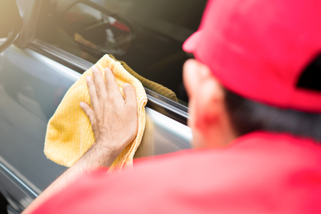 microfiber: Auto service staff cleaning car door with microfiber cloth