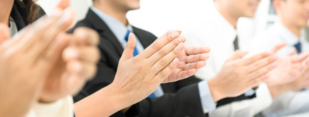 Group of business people clapping their hands at the meeting, panoramic banner Stock Photo
