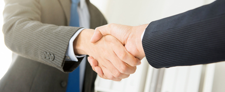Businessmen making handshake, panoramic banner - greeting, dealing, merger and acquisition concepts Stock Photo