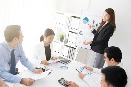 Asian business woman presenting her work in the meeting
