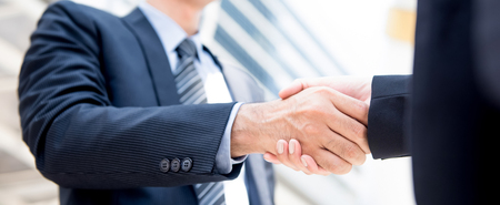 Businessman making handshake with a businesswoman, panoramic banner Stock Photo