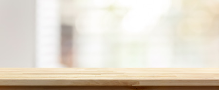 Wood table top on blur abstract white gray banner background - can be used for display or montage your products (foods)
