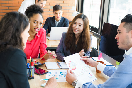 Multiethnic business people having a meeting in co-working space Stock Photo
