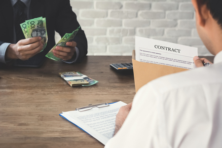 venal: Business partner making a contract - loan, bribery and corruption concepts