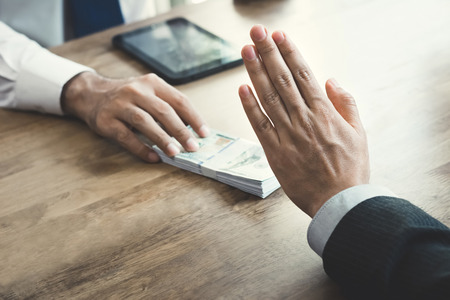 venal: Businessman rejecting money that offered by a man- anti bribery and corruption concept Stock Photo
