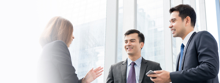 Group of business people talking at building hallway - web banner Stock Photo