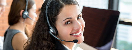Smiling telemarketing customer service agents, call center job concept - panoramic banner Stock Photo
