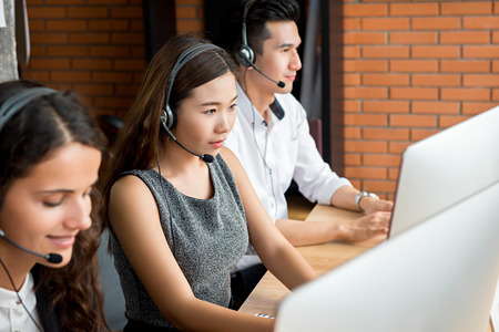 Multiethnic telemarketing customer service agent team, call center job concept