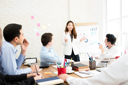 Asian business woman leader conducting company sales presentation in the meeting Stock Photo