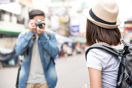 Traveling Asian couple tourist backpackers taking photo in Khao san road,  Bangkok, Thailand on holidays Imagens