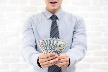 Happy businessman just receiving US dollar money