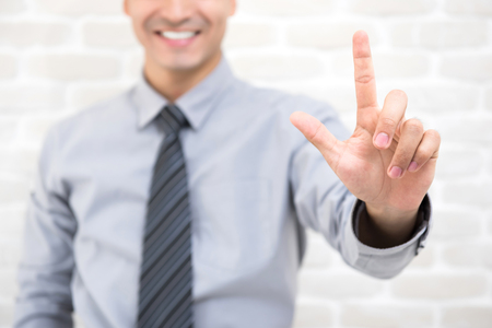 Businessman hand touching and gesturing on empty imaginary virtual screen