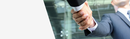 Handshake of businessmen, panoramic banner background with copy space