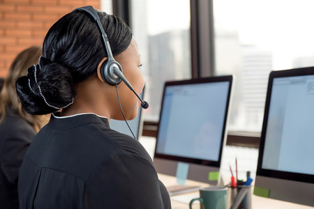 Black businesswoman working in call center as a telemarketing customer service agent