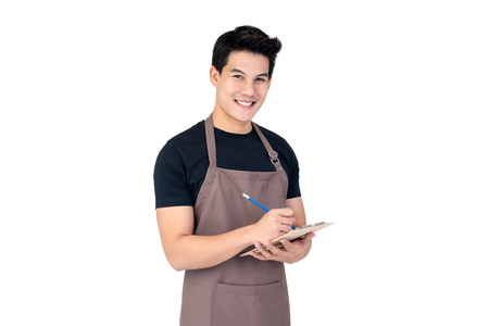 Young handsome smiling Asian man barista taking order with service mind, studio shot isolated on white background 스톡 콘텐츠