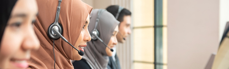 Web banner of muslim customer service operator team working in call center office