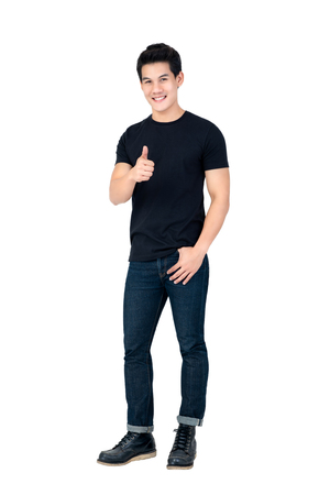 Casual smiling handsome Asian man giving thumbs up studio shot isolated on white background Foto de archivo - 114000704