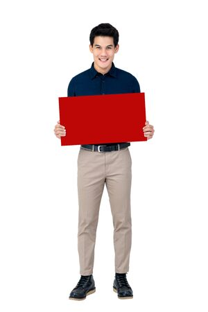 Young smiling handsome Asian man holding blank red board studio shot isolated on white background Reklamní fotografie