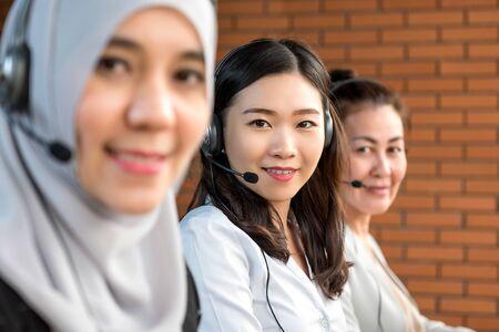 International diverse women working in call center office as customer service operators
