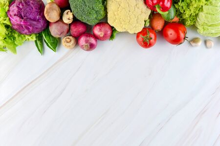 Fresh colorful healthy vegetables on marble kitchen countertop background with copy space