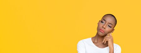 African American woman feeling bored on yellow isolated studio banner background with copy space