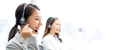 Banner of smiling telemarketing Asian woman working in call center office