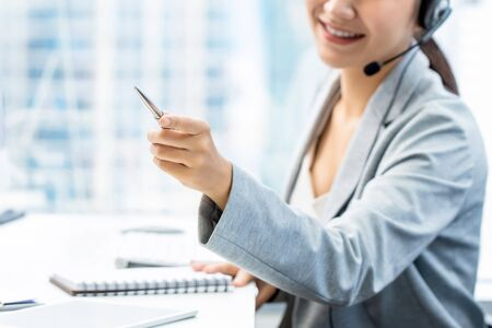 Woman telemarketing staff supervisor pointing hand while working in office