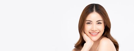 Youthful smiling Asian woman isolated on white banner background for beauty and skin care concepts