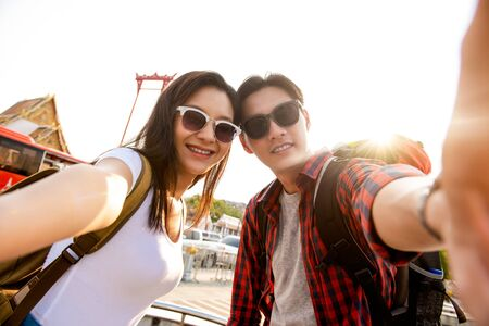 Asian couple tourists taking selfie while traveling on summer vacations in Bangkok Thailand Stock fotó - 145324434