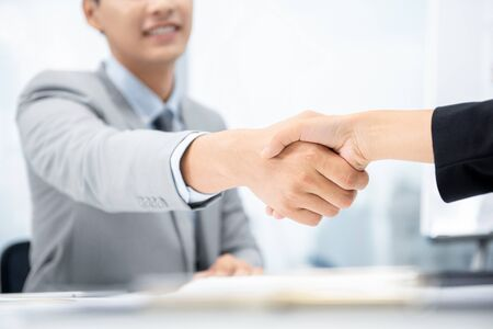 Happy businessman making handshake with businesswoman at meeting room in city office for merger and acquisition concept Stock fotó