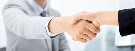 Businesspeople making handshake at meeting room in city office for merger and acquisition concept