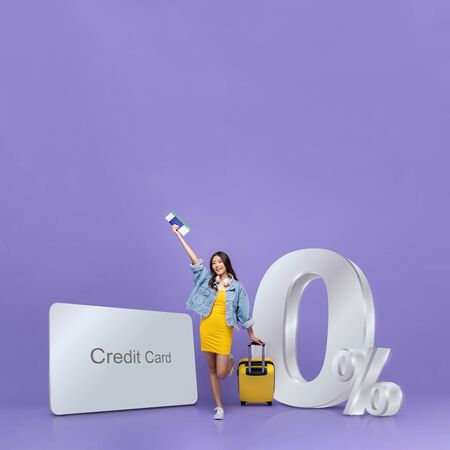Smiling happy Asian tourist woman and credit card with 0% interest installment payment plan promotion against purple background with copy space