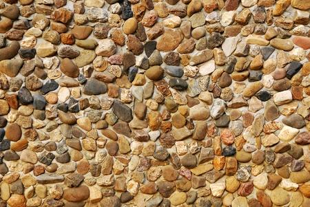 irregular shapes: Muro de ladrillo tradicional de piedra hecha de piedras en fragmentos de formas irregulares