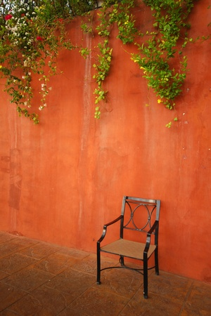 medioeval: Chair against red wall