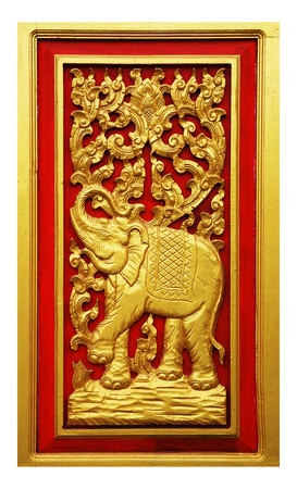 thai painting: Elephant carved gold paint on door  Stock Photo