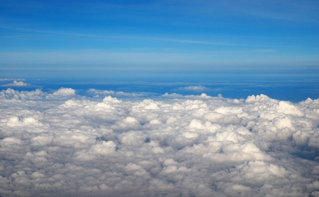 spiritual background: View above the earth at the clouds below