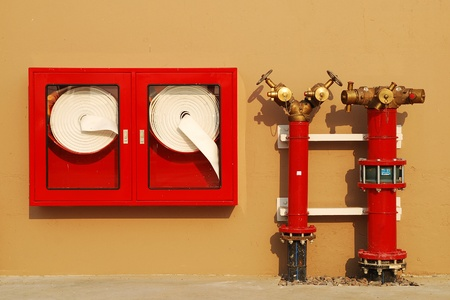Hydrant with water hoses and fire extinguish equipment Stock Photo - 12969053