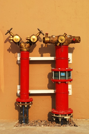 fire fighting equipment: Hydrant with water hoses and fire extinguish equipment