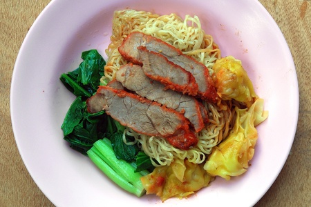 Egg chinese dry noodles with roast red pork photo
