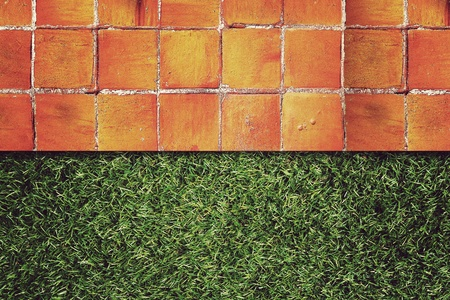 Wall Background on green grass,Vintage style photo