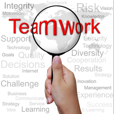 Teamwork, word in Magnifying glass ,business background Stock Photo - 13309461