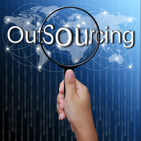 OutSourcing, word in Magnifying glass,network background photo