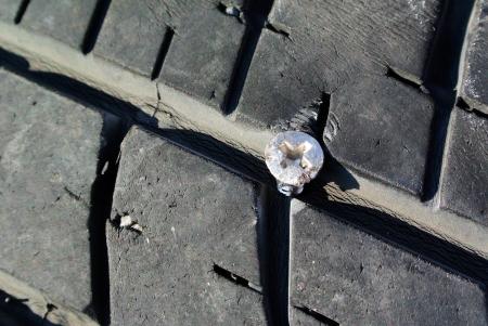 Screw puncturing tire photo