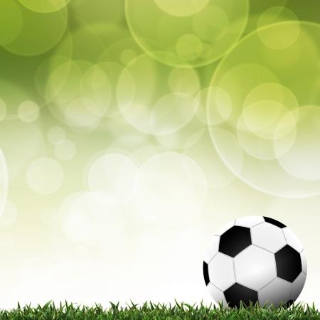 Football dans l'herbe verte avec un fond coloré
