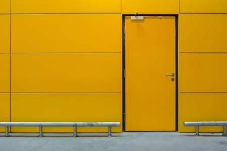 magnetic: Yellow door with security lock Stock Photo