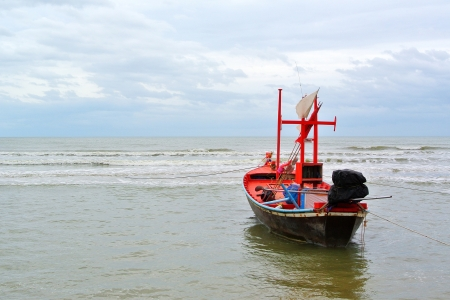 A small wooden fishing boat photo