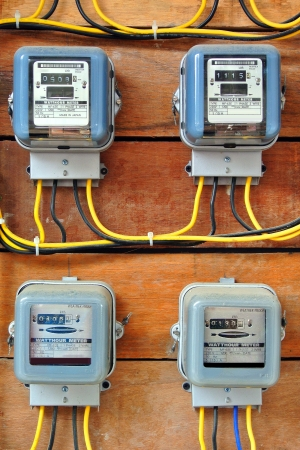electricity prices: A row of electric meters measuring power use Stock Photo