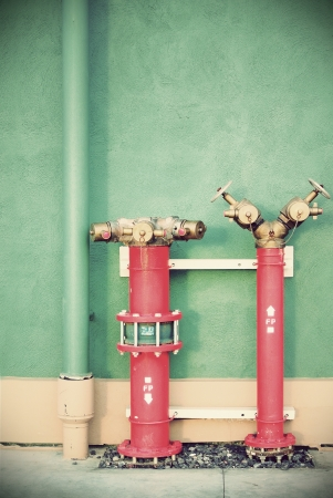 Vintage Hydrant with water hoses and fire extinguish equipment photo
