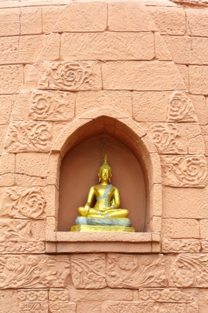 dogma: Buddha statue on brick wall