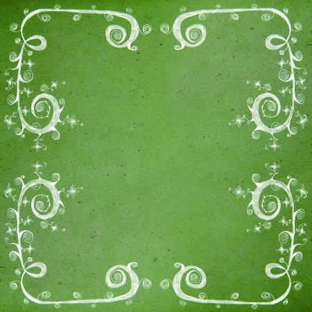 Drawing flower frame on old grunge paper background,vintage style photo